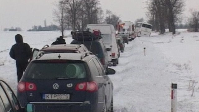 Queue of cars in snow