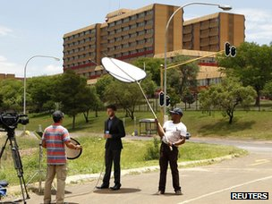 A television crew films outside a military hospital where former South African president Nelson Mandela is hospitalized in Pretoria