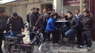 Lyse Doucet talking to people at a cafe in Siliana