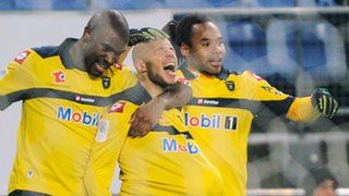 Yassin Mikari (centre) shows his delight after scoring