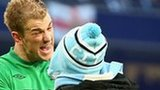 Joe Hart confronts a fan on the pitch at Etihad Stadium