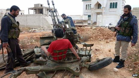 Rebel fighters man an anti-aircraft gun in Base 111 at Sheikh Suleiman (09 December 2012)