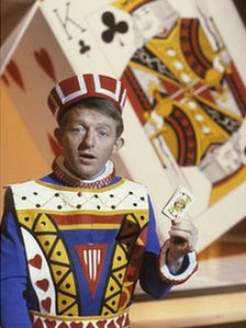 Paul Daniels doing as card trick
