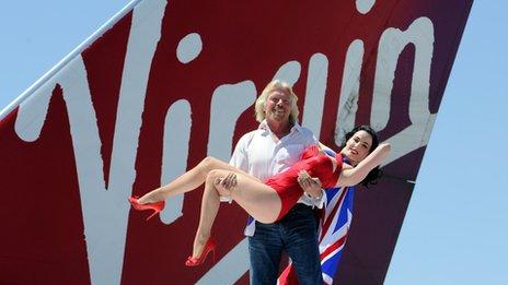 Sir Richard Branson and Dita von Teese on a Virgin aeroplane