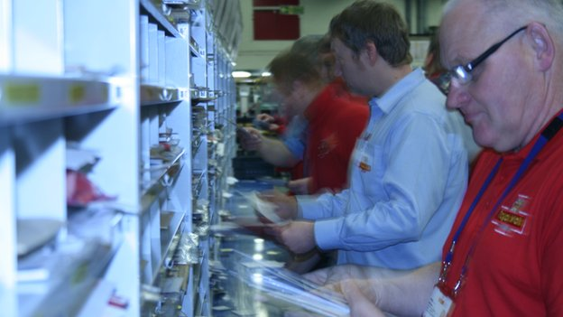 Posties sorting mail