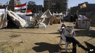 A man reading in front of a protest tent in Tahrir Square, 10 December 2012