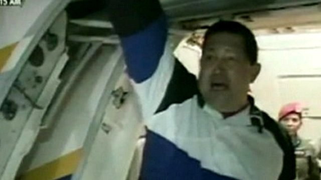 President Hugo Chavez boards a plane