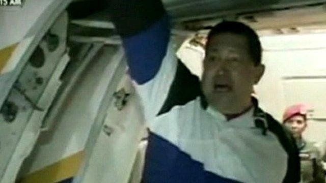 President Hugo Chavez boards a plane