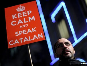 A Catalan language supporter demonstrates in Barcelona, 10 December