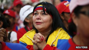 A Chavez supporter prays for his health on 9 December