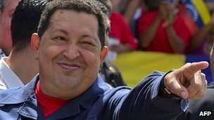 Hugo Chavez gestures before voting in the 7 October election
