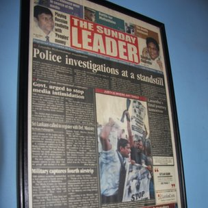 A framed copy of the first edition of the Leader published after former editor Lasantha Wickrematunge&#039;s death