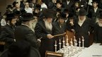 Ultra Orthodox Jewish men light candles