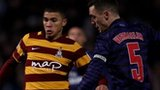 Nahki Wells of Bradford and Thomas Vermaelen of Arsenal