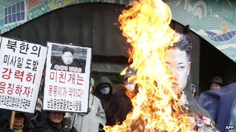 Protesters burn an effigy of the North Korean leader Kim Jong-un after his country's missile launch