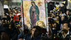 Pilgrims carry an image of the Virgin of Guadalupe
