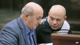 Murder suspect Dmitry Pavlyuchenkov (right) speaks to his lawyer in court, 12 December