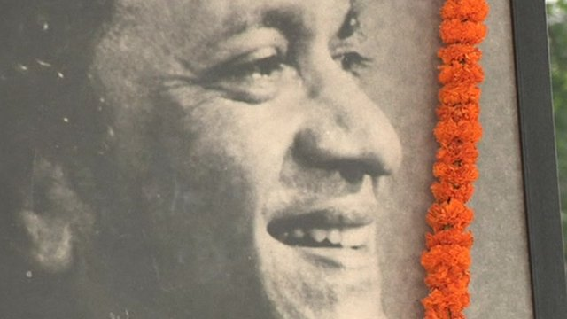 Photograph of Ravi Shankar with flower garland