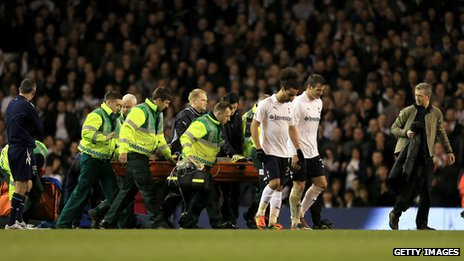 Dr Andrew Deaner on the pitch as Fabrice Muamba is stretchered off