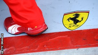 Ferrari mechanic's foot