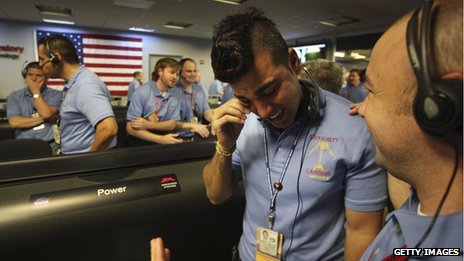 Bobak Ferdowsi  wipes tears away after the successful landing inside of NASA's Mars Science Laboratory Curiosity rover