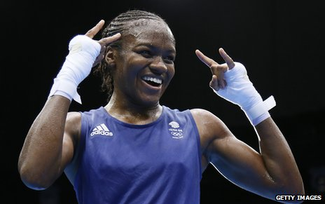Nicola Adams celebrates winning gold at the Olympics