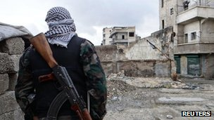 "A Free Syrian Army fighter takes position in Aleppo""s al-Amereya district on 11 December"