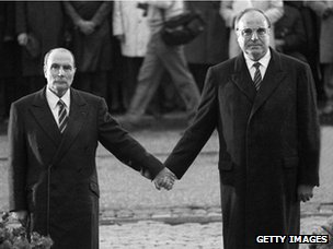 Francois Mitterrand (left) and Helmut Kohl hold hands at Verdun in 1984