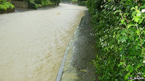 Flooding in Noverton Lane, Prestbury, during summer 2007. Image courtesy Liz Wager