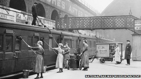 Women workers using an industrial vacuum cleaner to clean railway carriages at London Bridge Station, 1918