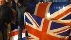 Protesters in NI holding union flag
