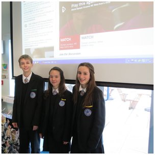 Upton pupils, with the World Class debate feed visible behind them - good work!
