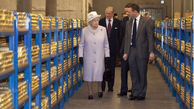The Queen and Prince Philip in the gold vault of the Bank of England