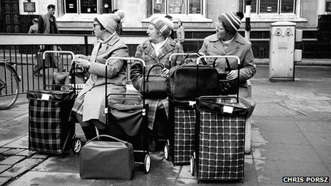 Ladies wait with their shopping trolleys in Peterborough