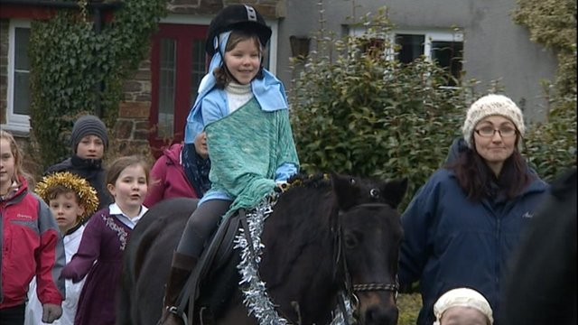 'Mary' makes her way through Walkhampton in the Lady Modiford Primary school Nativity play