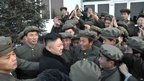 North Korean leader Kim Jong-Un (lower left) celebrating with members from the satellite control centre during the launch of the Unha-3 rocket in Pyongyang, 12 December 2012