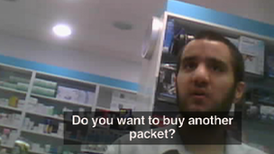 Man offering another packet of pills