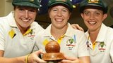Australia's Rene Farrell, Alex Blackwell and Sarah Elliott with the women's Ashes trophy