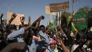 Malians protest in favour of an international military intervention to regain control of the country&#039;s Islamist-controlled north, in Bamako, Mali, Saturday, Dec. 8, 2012. 
