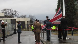 Union jack being lowered at GCHQ Oakley