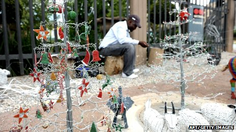 A street vendor sells Christmas decorations in Johannesburg