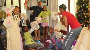 Milton Nkosi's family open their Christmas gifts