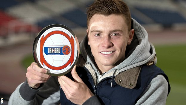 Rangers midfielder Lewis MacLeod shows off his award
