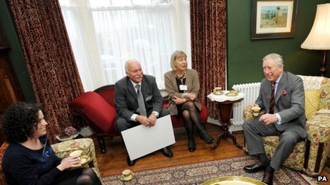 Prince Charles in the living room of the birthplace of Dylan Thomas in Swansea with (left to right) granddaughter of Dylan Thomas, Hannah Ellis Thomas, and restorers of the house Geoff Haden and Anne Haden