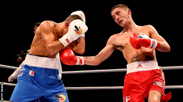The British Lionhearts's Andrew Selby (right) in control against the German Eagles's Redouane Asloum.