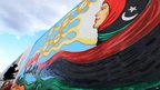 A mural being painted on the walls of the former Libyan leader's compound in Tripoli - Sunday 9 December 2012