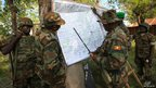 Commanders from African Union force looking at a map of Jowhar in Somalia - Monday 10 December 2012