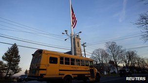 Flag flies at half mast along Main Street, Newtown, Connecticut, on 14/12/12