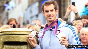 Andy Murray with a gold post box in Dunblane