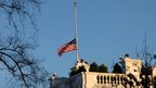 A flag flies at half-mast at the White House